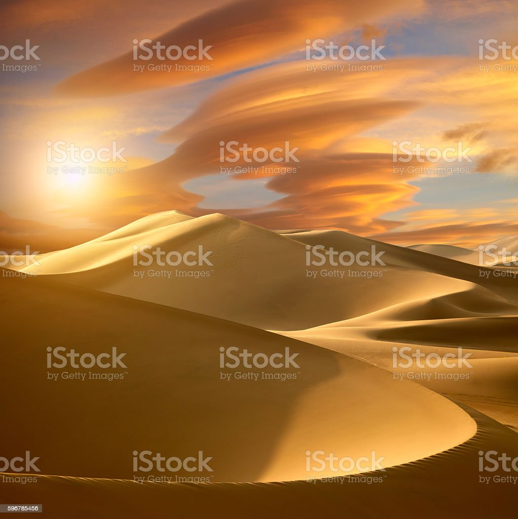 Sunset in the desert stock photo
