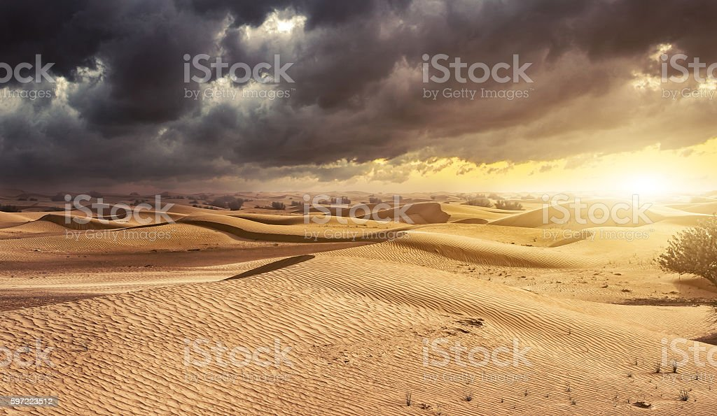 Sunset in the desert sand dunes background stock photo