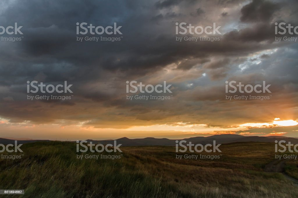 Sunset in the desert, the sun's rays Shine through the clouds. Ukok Plateau Of Altai. Fabulous cold landscapes. No one around stock photo