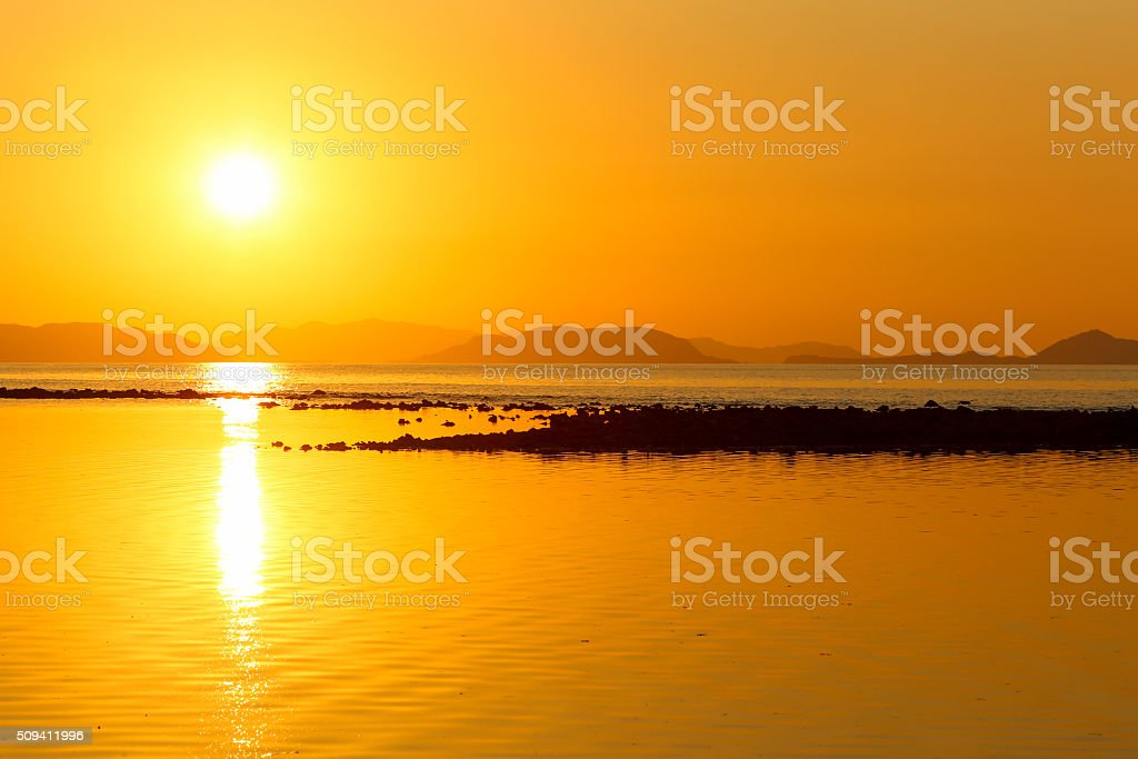 Sunset in the Flores Sea, Indonesia. stock photo