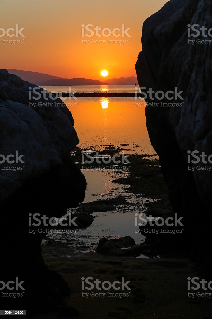 Sunset in the island at Flores sea, Indonesia stock photo
