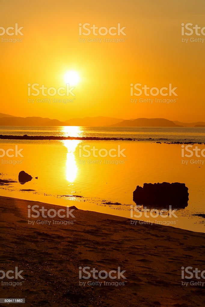 Sunset in the lonely island, Indonesia. stock photo