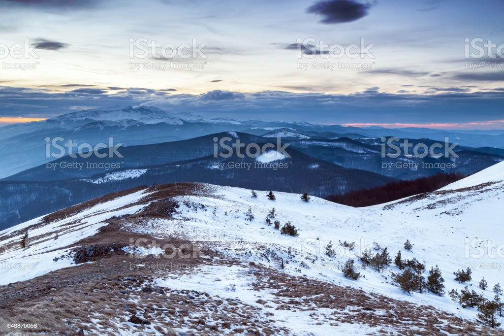 Sunset in the mountain in winter stock photo