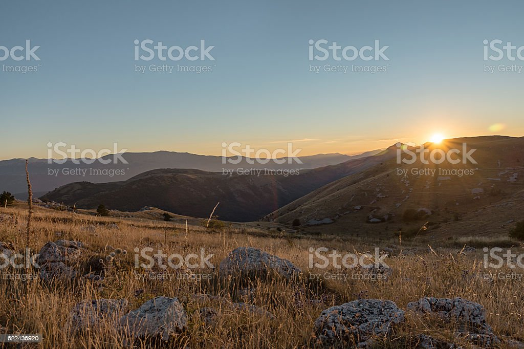 Sunset in the mountain stock photo