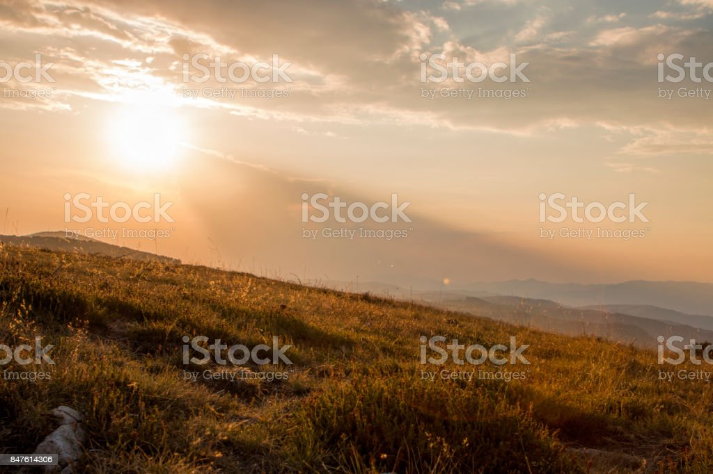 Sunset in the mountains stock photo