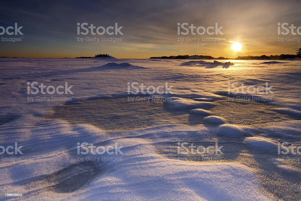 Sunset in the snowy beach royalty-free stock photo