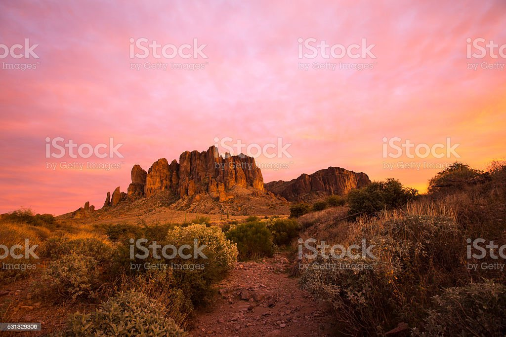 sunset in the superstition mountains stock photo