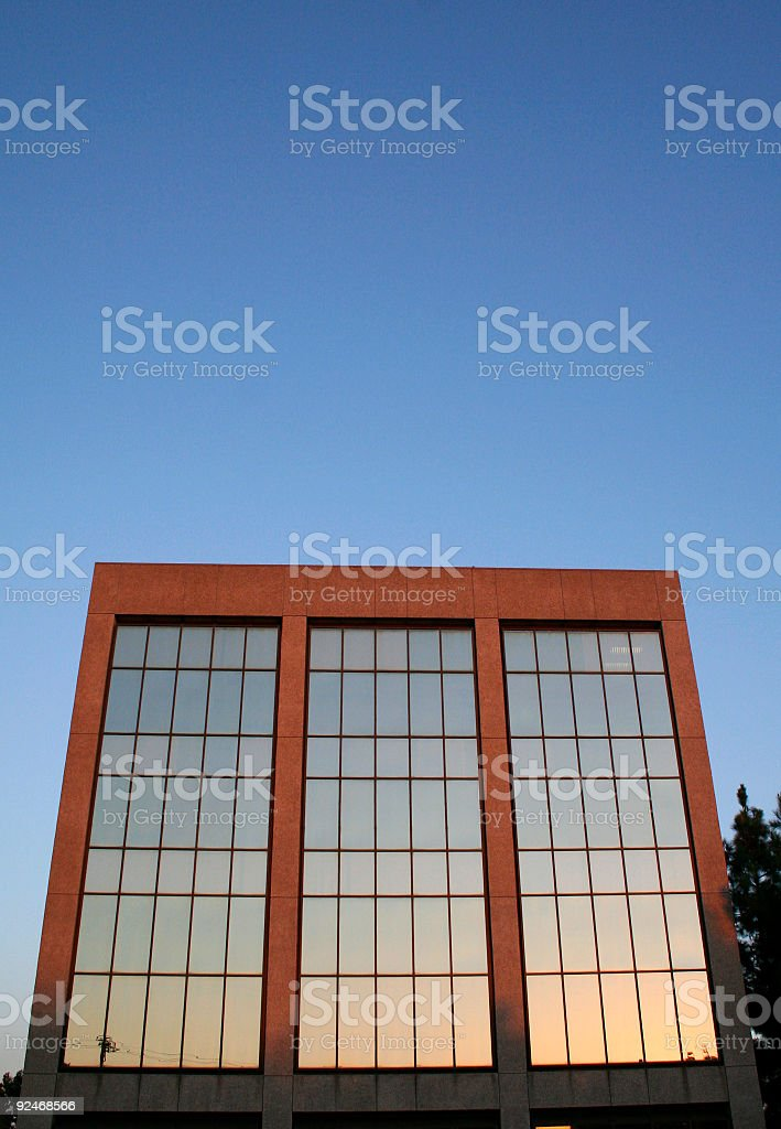 sunset in the windows of a medical building royalty-free stock photo