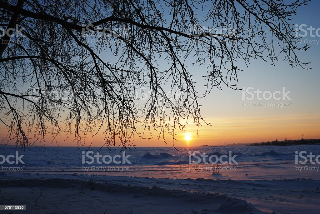 sunset in the winter on Lake Onega stock photo