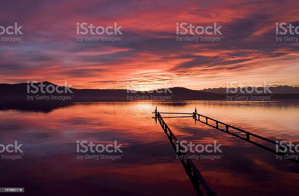 sunset in viverone stock photo