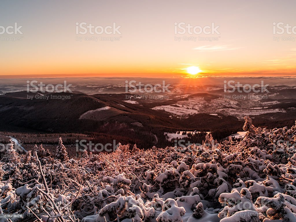Sunset in winter mountains stock photo