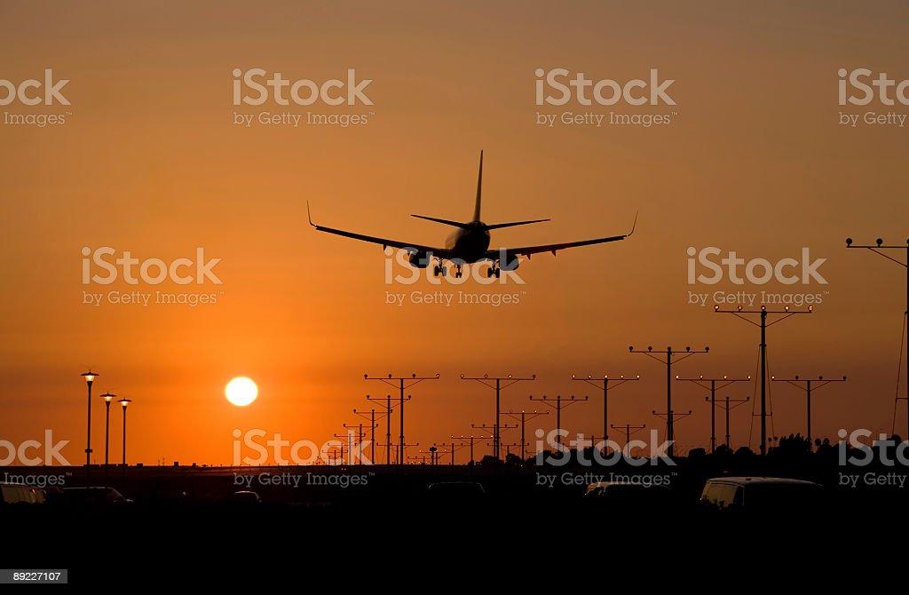 Sunset Jet Landing 1 stock photo