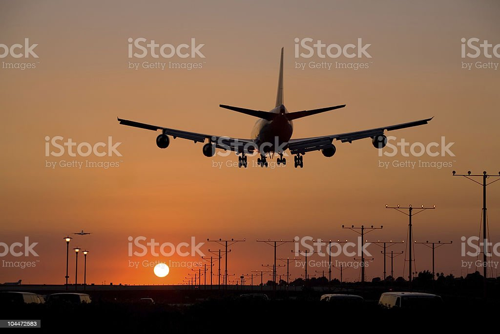 Sunset Jet Landing 2 royalty-free stock photo