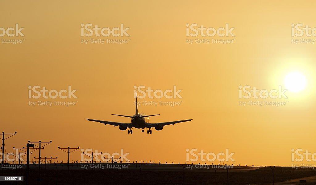 Sunset Jet Landing stock photo