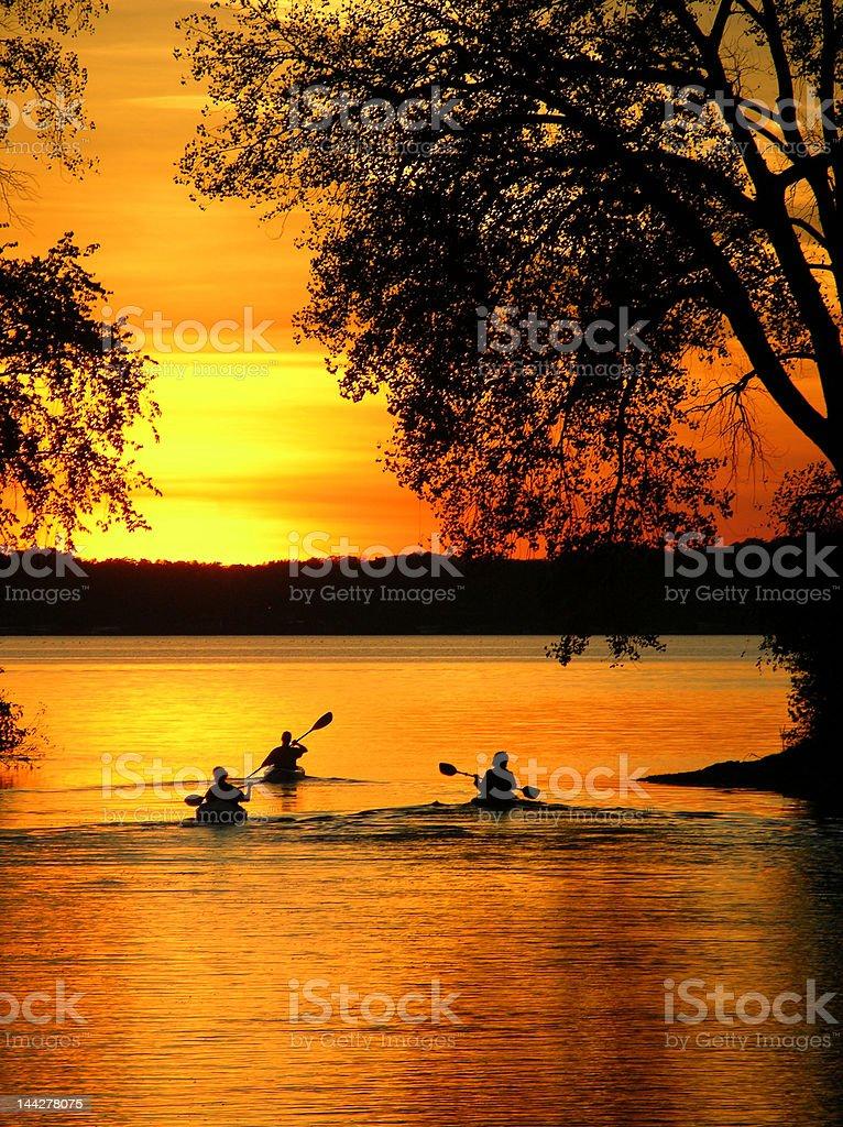 Sunset Kayakers royalty-free stock photo
