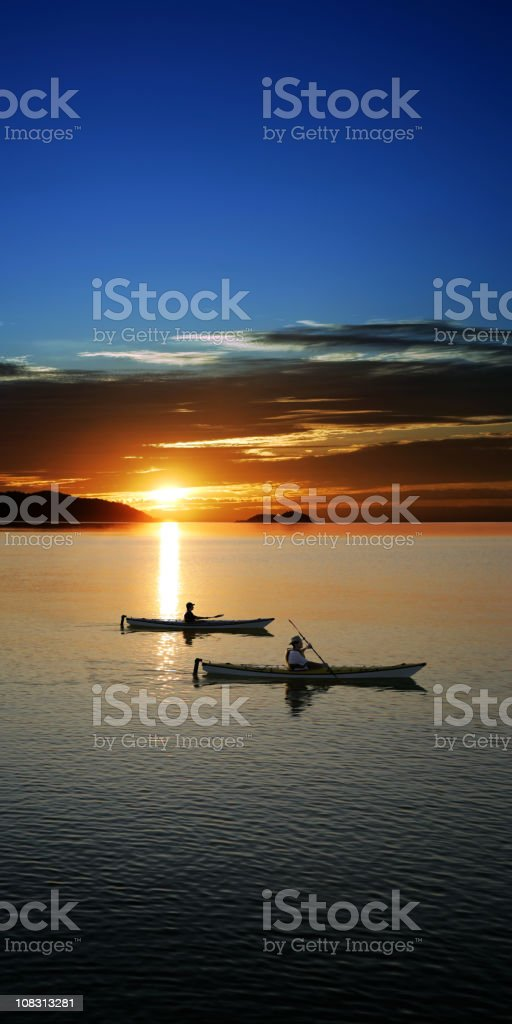 XXXL sunset kayaking stock photo