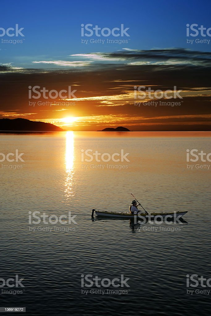 XXL sunset kayaking stock photo