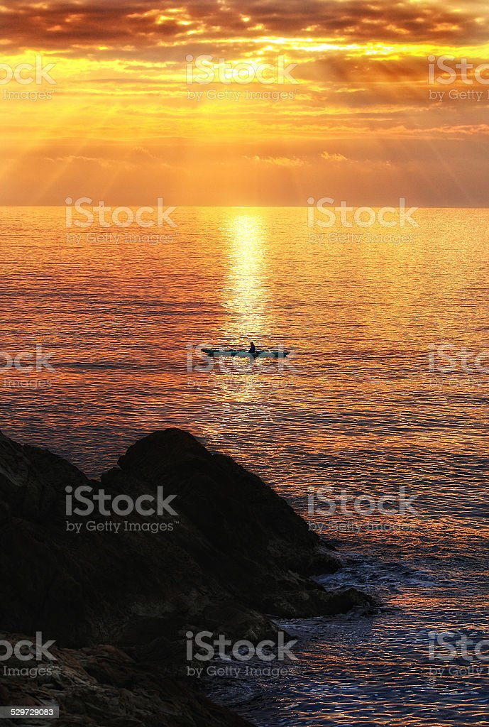 Sunset kayaking stock photo