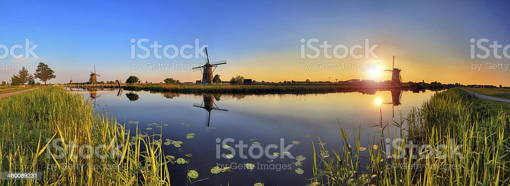 180 sunset Kinderdijk stock photo