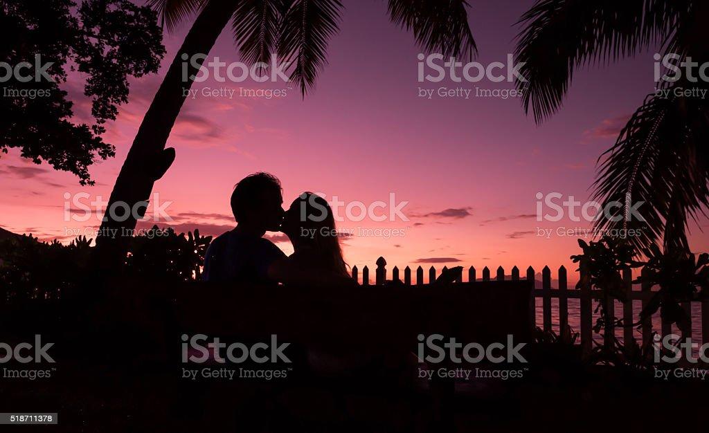 sunset kiss stock photo
