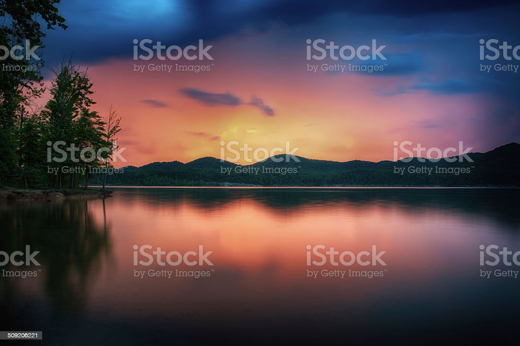 Sunset Lake and Storm Clouds stock photo