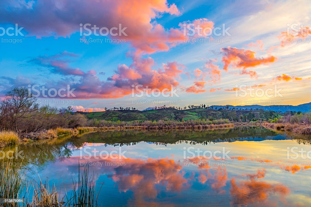 Sunset lake reflections at dusk with cloudscape,CA stock photo