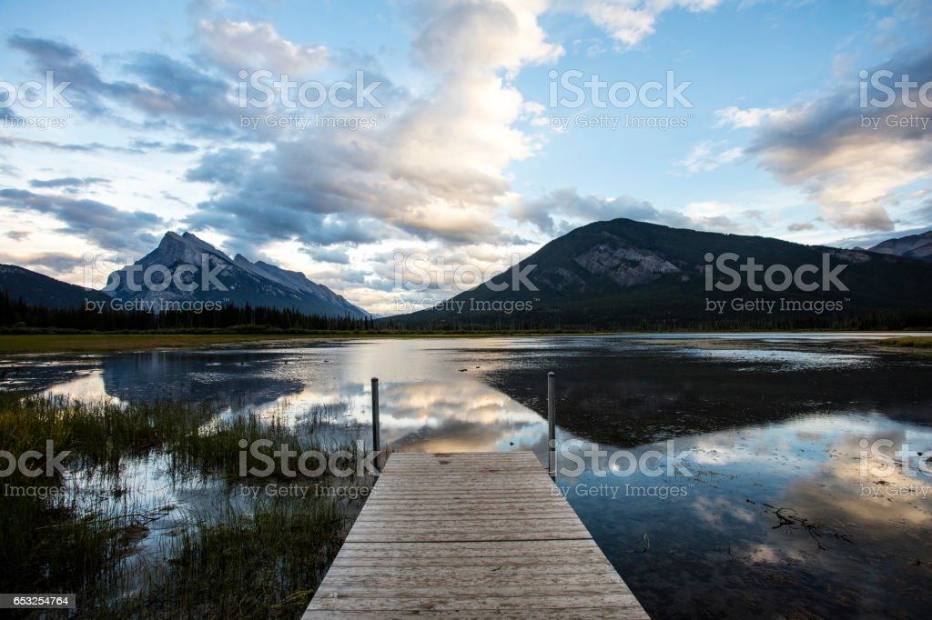 Sunset Lake Reflections on The Pier stock photo