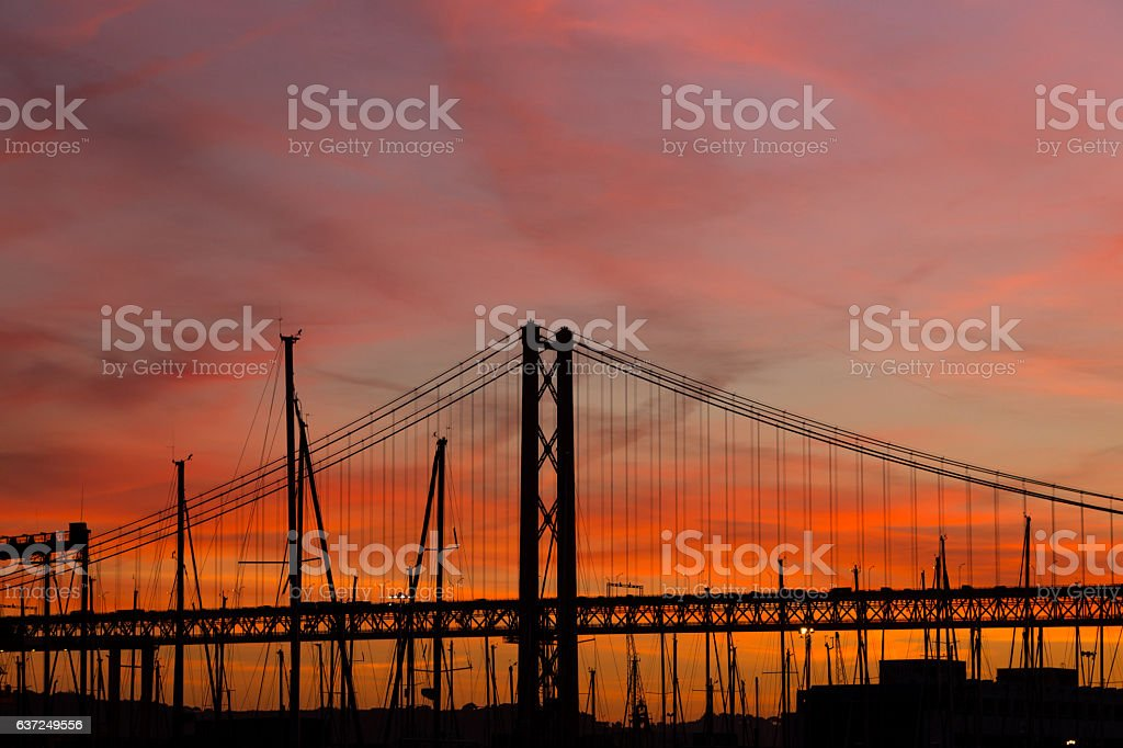 sunset landscape in city with bridge and yachts stock photo