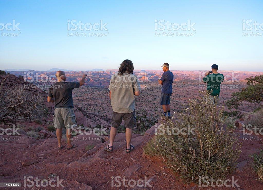 sunset landscape men talking royalty-free stock photo