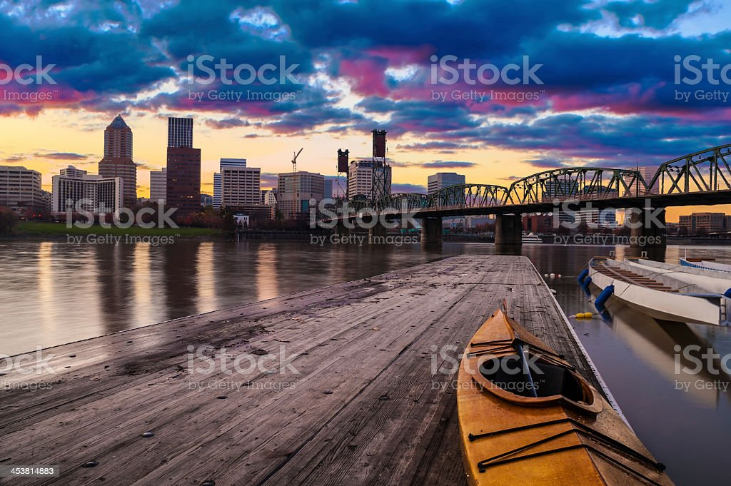 A sunset landscape of the city skyline viewed from a dock  stock photo