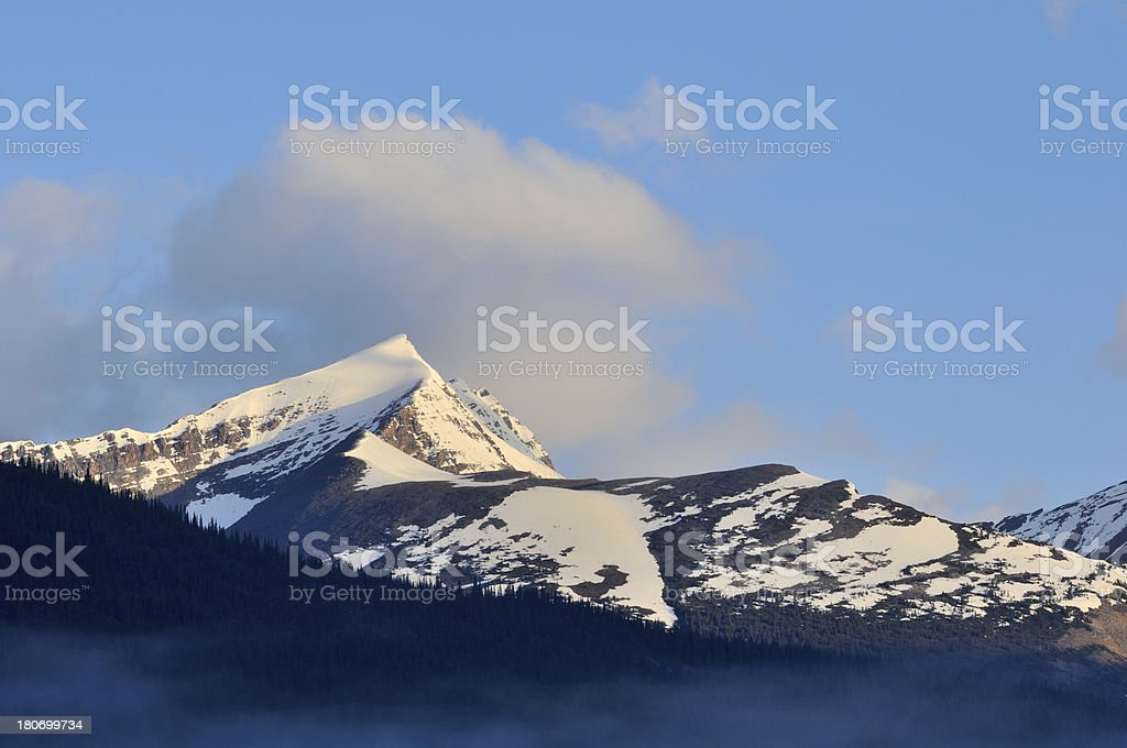 Sunset landscape with snowcapped peak in Canadian Rockies royalty-free stock photo