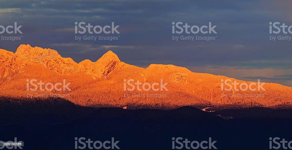 Sunset Light on Snow Mountains stock photo