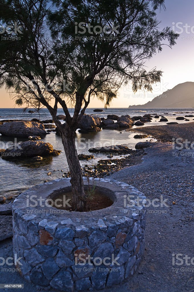 Sunset light on the rocks at Plakias bay, Crete island stock photo