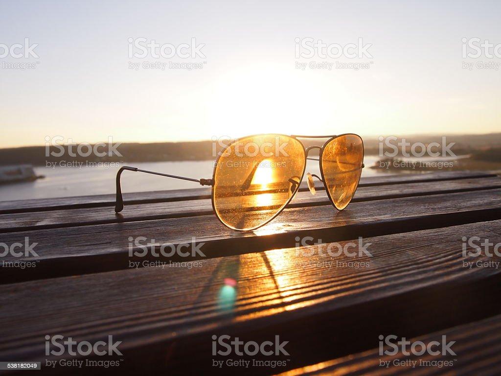 Sunset light with glasses lens stock photo