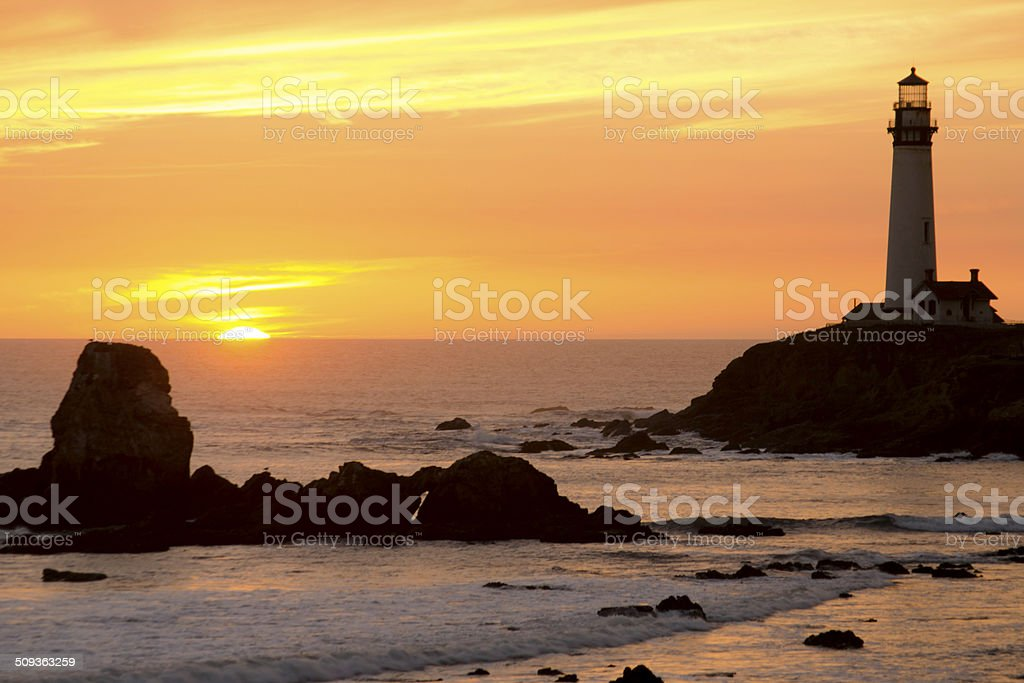 Sunset lighthouse stock photo