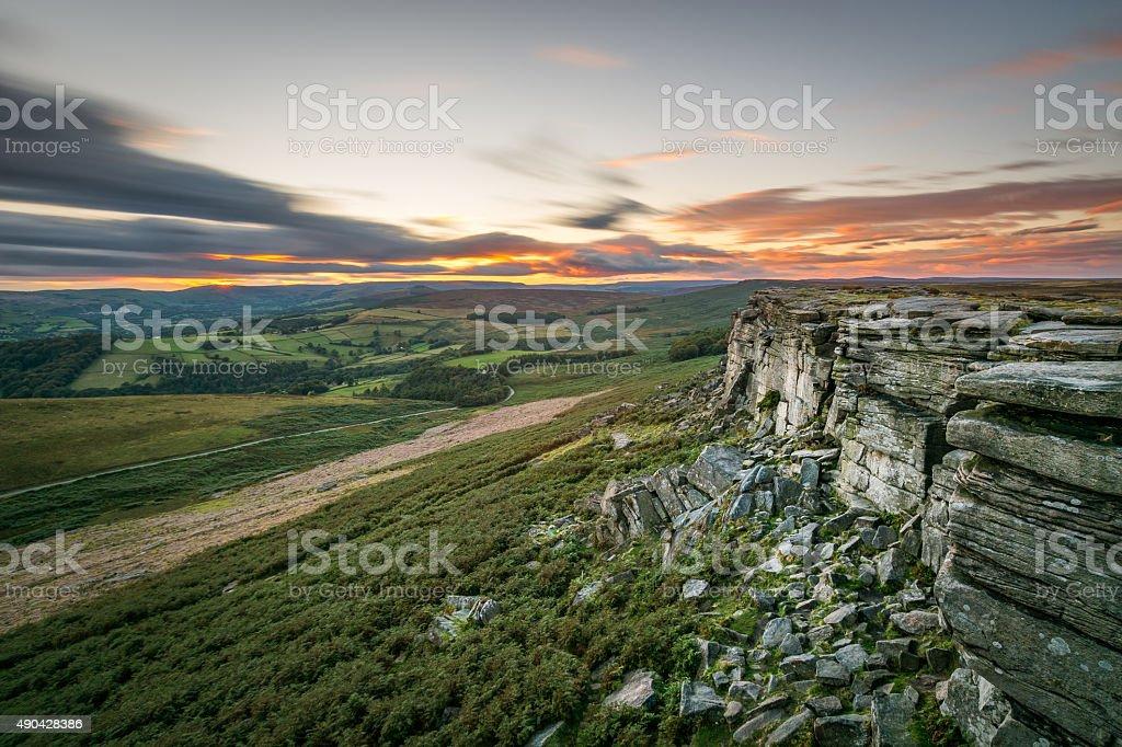 Sunset Long Exposure With Orange Sky At Stanage Edge. stock photo