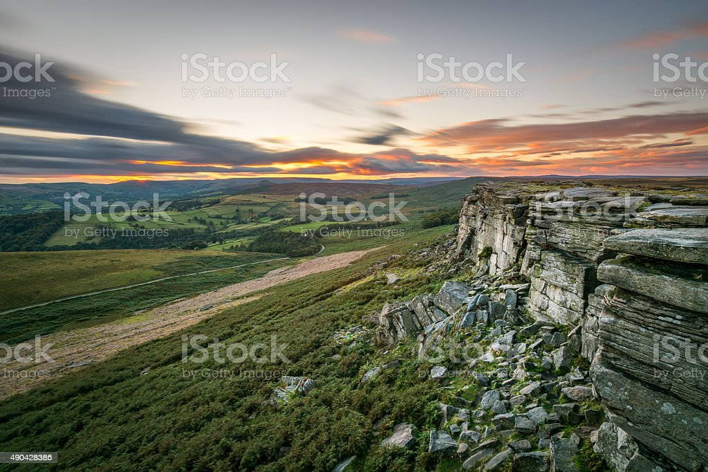 Sunset Long Exposure With Orange Sky At Stanage Edge. stock photo