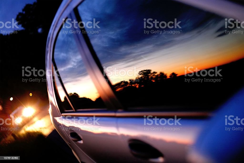Sunset mirror in a car window stock photo