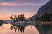 Sunset Mountain Lake With Pink Calm Waters, Altai Mountains Highland