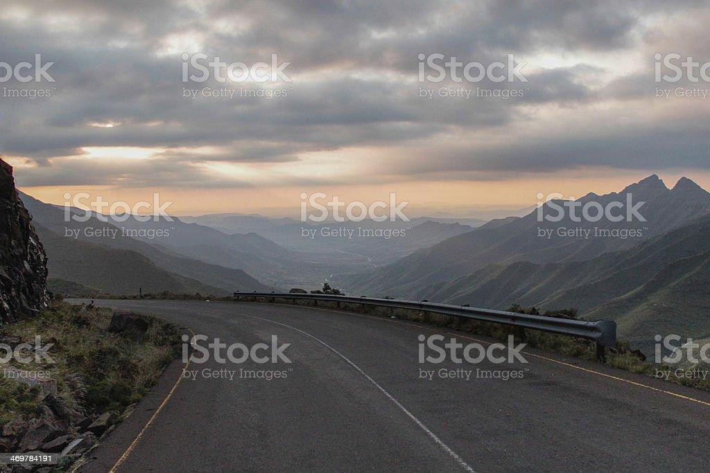 Sunset mountain road stock photo