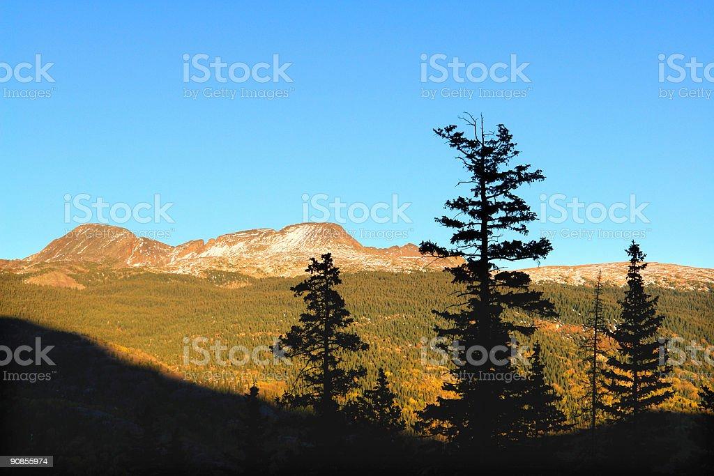 sunset mountain tree silhouettes royalty-free stock photo
