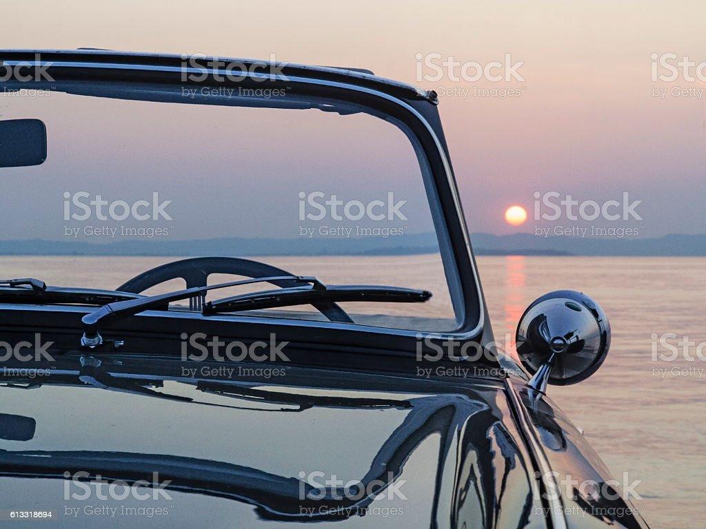 Sunset near the car stock photo