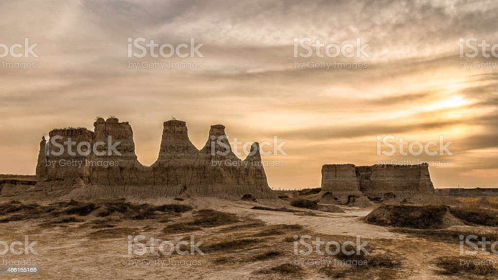 Sunset of clay forest with cloudy sky stock photo