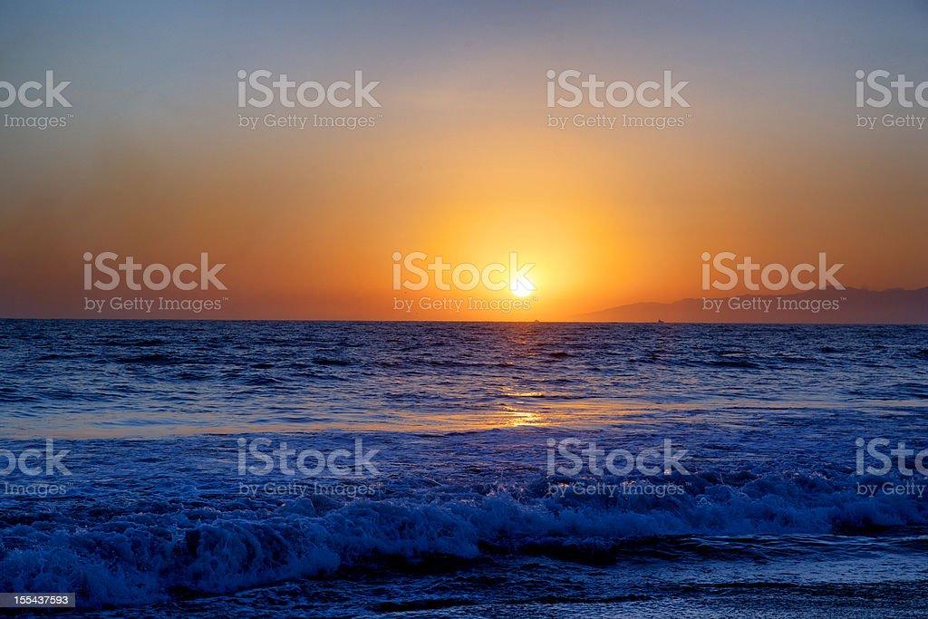 Sunset of Southern California Summer Sky Sun Ocean Waves stock photo