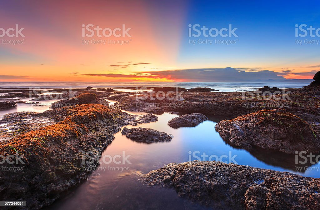 Sunset of Tanah Lot beach in bali indonesia stock photo