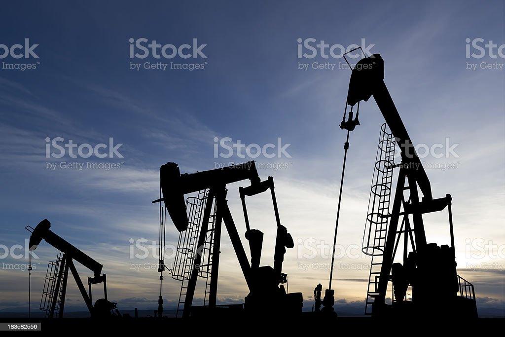 Sunset Oil Derricks royalty-free stock photo