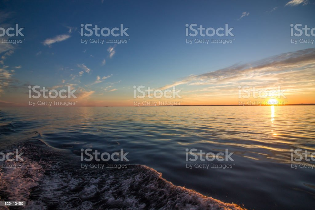 Sunset on a boat in midcoast Maine stock photo