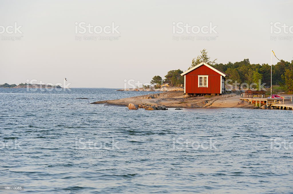 Sunset on a cute little cottage in the archipelago stock photo