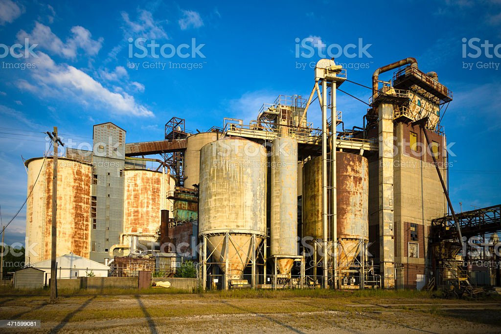 Sunset on a derelict, rusty factory royalty-free stock photo