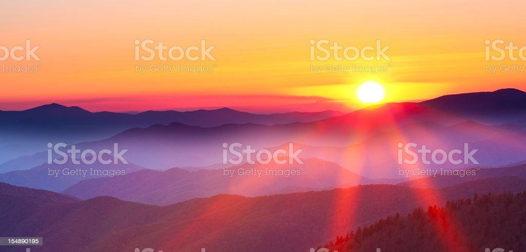 Sunset on a foggy mountain range stock photo